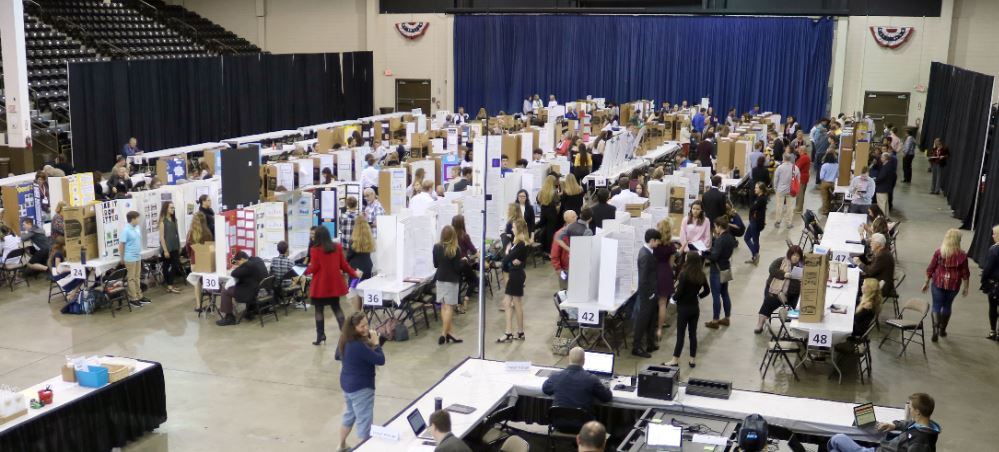 Zoomed-out crowd photo of attendees at the STEM Fair 2019