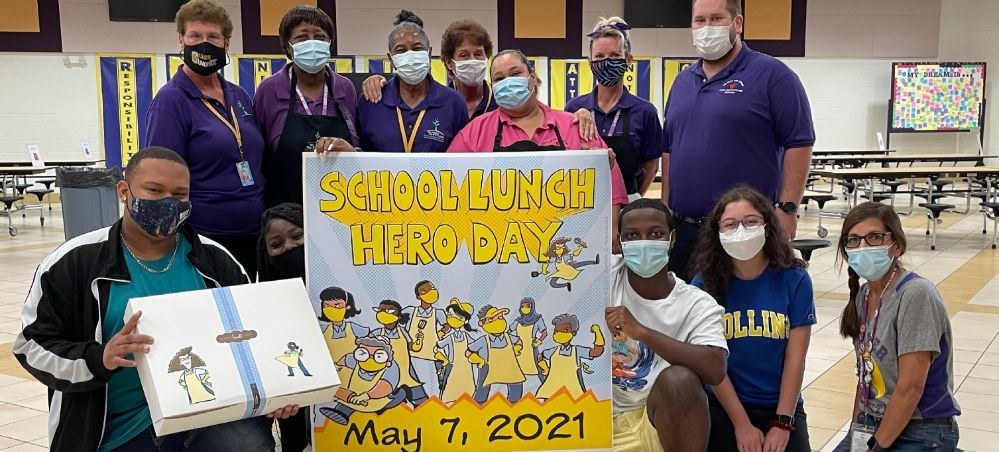 Booker High School cafeteria works & students with a School Lunch Hero poster