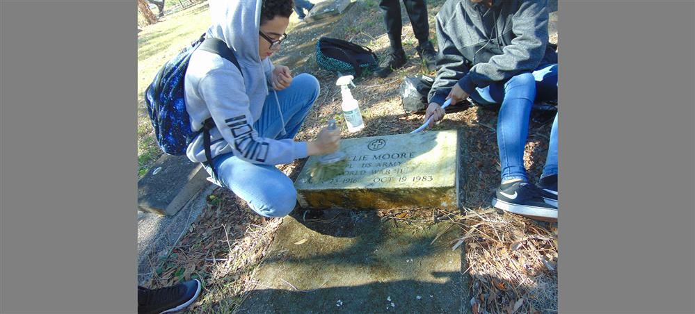 Booker High JROTC cadets clean servicemen's graves at cemetery
