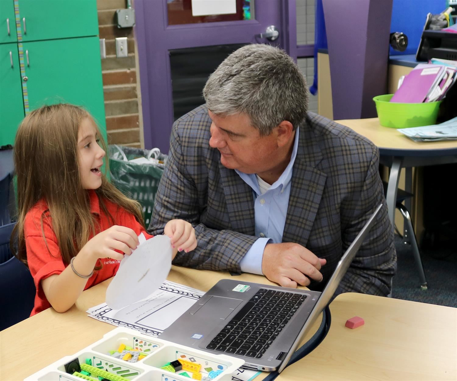 Dr. Bowden learning about an Alta Vista student's project
