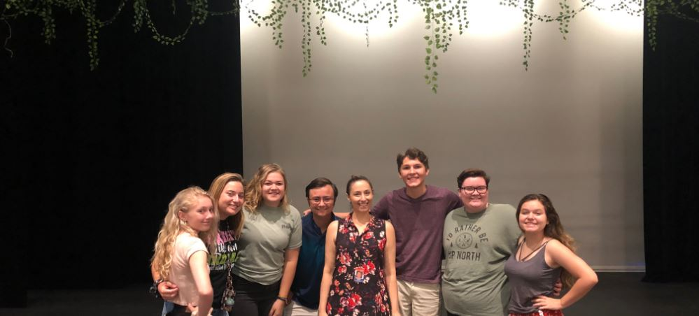 Student cast and crew members on-stage